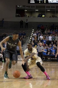 Guard Rashad Ray fights for a loose ball against Keith Pinckney (#1). With SMU's loss to Connecticut on Sunday afternoon, the Golden Hurricane sits atop the American standings. The conference will be decided on Sunday when TU travels to Dallas to take on SMU.