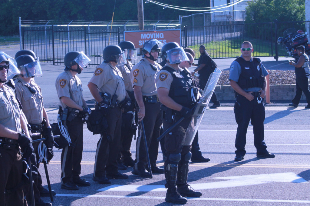 Police in Ferguson wait for protestors on August 13, 2014 during the Michael Brown protests. The killing of Michael Brown by a Ferguson Police officer brought national attention to the police department's practices and caused the Department of Justice to investigate Ferguson's law enforcement practices.