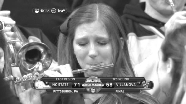 """Sad Piccolo Girl"" became an internet sensation the night after a March Madness basketball game. This picture is potentially embarrassing, and she might want the right to be forgotten! Courtesy NBC Sports"