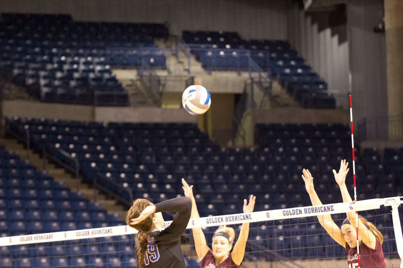 Rebecca Reeve goes up for the spike against Southern Illinois. Reeve had a team-high two aces and three blocks in Saturday's loss.