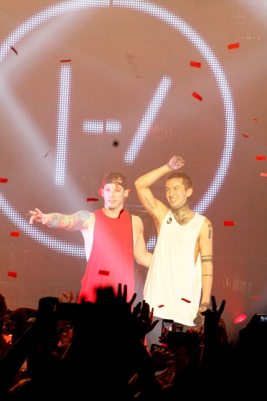 Left to right: Josh Dun and Tyler Joseph bid farewell to their fans at the close of their performance.