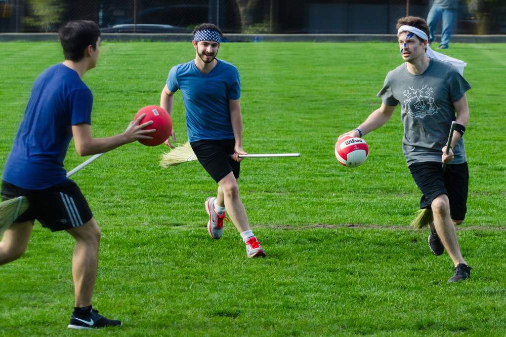 College students playing competetive quidditch.